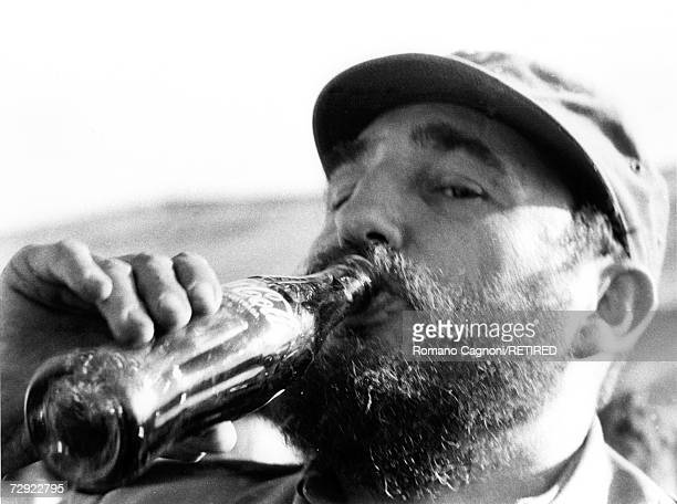 Cuban premier Fidel Castro drinking a bottle of CocaCola circa 1972