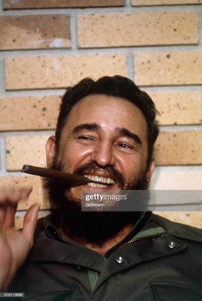 Cuban Premier <a gi-track='captionPersonalityLinkClicked' href=/galleries/search?phrase=Fidel+Castro&family=editorial&specificpeople=67210 ng-click='$event.stopPropagation()'>Fidel Castro</a> flashes a big smile as he puffs a cigar, during an interview by American newsmen accompanying Senators Jacob K. Javits, (R-N.Y.), and Clairborne Pell, (D-RI), on a recent visit.