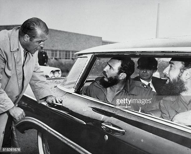 Cuban Premier Fidel Castro leans out of window of car to deliver a few choice words to a Security Officer at Idlewild Airport here September 18th...
