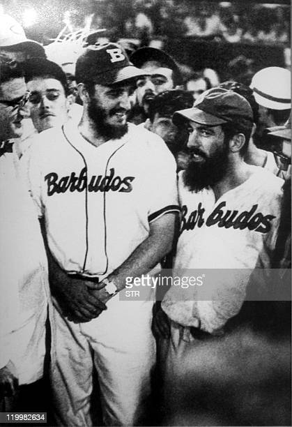 Cuban President Fidel Castro and Commander Camilo Cienfuegos laugh during a baseball match between the own 'rebels' in Havana shortly after toppling...