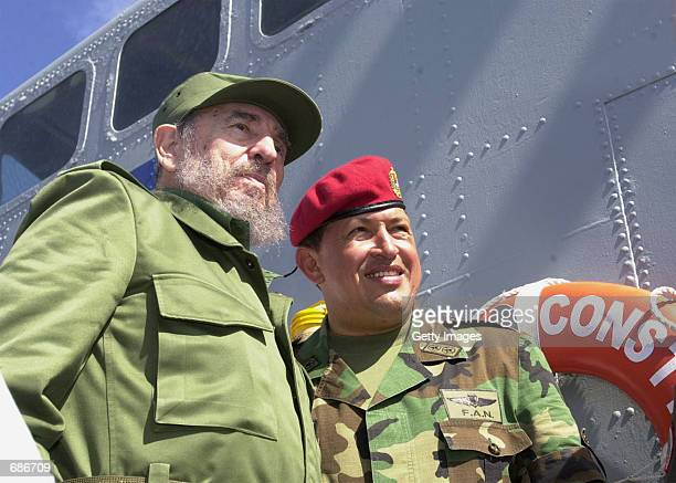 Cuban President Fidel Castro and Venezuelan President Hugo Chavez travel onboard a Venezuelan Navy vessel from Porlamar to Pampatar prior a ceremony...