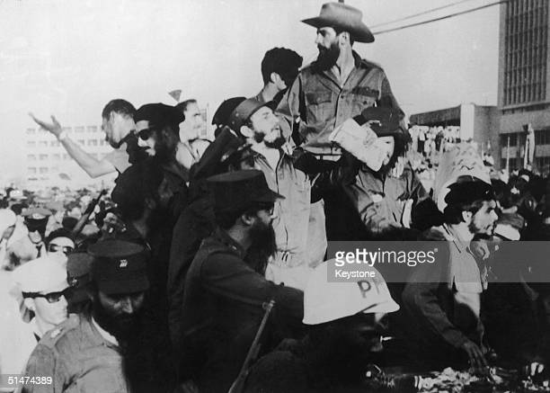 Cuban President Fidel Castro centre arriving in Havana Cuba with Che Geuvara right and Major Camilo Cienfeugos top 1st December 1959