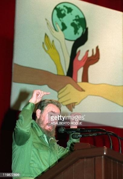 Cuban President Fidel Castro delivers a speech criticizing capitalism and neoliberalism saying that 'they devour life and spirit' during a during a...