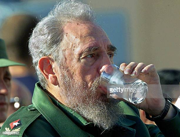 Cuban President Fidel Castro drinks a glass of water during an appearance 29 June 2001 in Havana Castro who suffered an attack of fatigue during a...