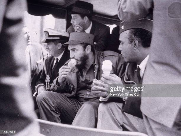 Cuban president Fidel Castro eats an ice cream cone as he rides in the Bronx Zoo train New York City April 2 1959
