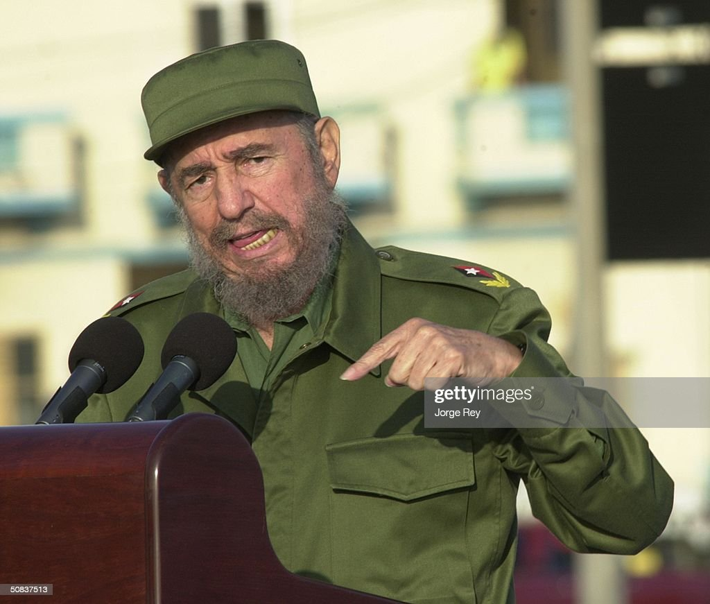 Cuban President <a gi-track='captionPersonalityLinkClicked' href=/galleries/search?phrase=Fidel+Castro&family=editorial&specificpeople=67210 ng-click='$event.stopPropagation()'>Fidel Castro</a> gives a speech in front of the U.S. Interest Section May 14, 2004 in Havana. Castro led a massive protest march against new U.S. moves aimed at speeding the end of his communist rule, and raised the prospect of a feared U.S. invasion.