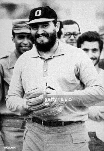 Cuban President Fidel Castro laughs during a baseball match between his 'rebels' in Havana shortly after toppling dictator Fulgencio Batista in 1959...