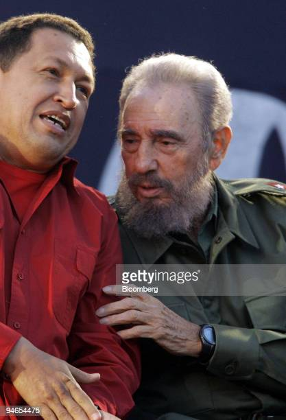 Cuban President Fidel Castro right speaks with Venezuelan President Hugo Chavez left during a rally following the Mercosur Summit in Cordoba...