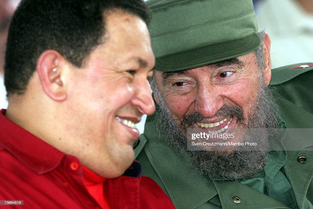 Cuban President Fidel Castro (R) smiles with President of Venezuela Hugo Chavez during the opening ceremony of the 15th annual international Cuban book fair in Havana, Cuba February 3, 2006.
