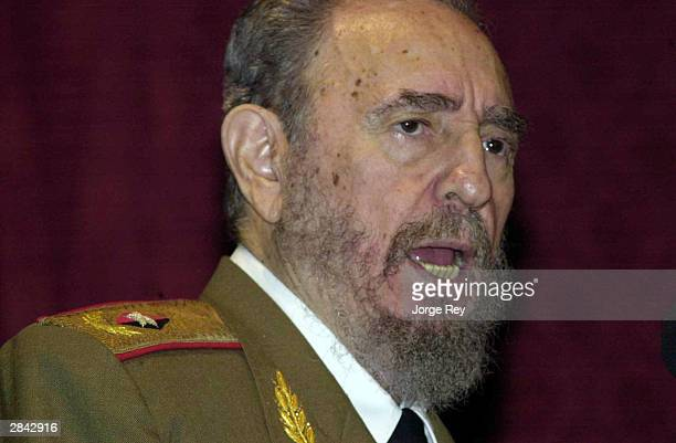 Cuban President Fidel Castro speaks in the Karl Marx Theater January 3 2004 in Havana Cuba Castro commemorated the 45th anniversary of the victory of...