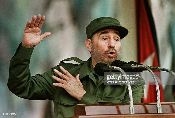 Cuban President Fidel Castro speaks to a crowd of some 1000 followers at a square in Bani a small town 40 miles west of Santo Domingo 23 August on...