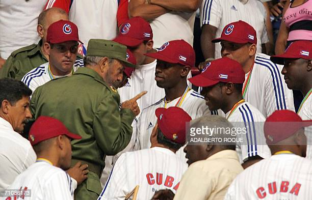 Cuban President Fidel Castro speaks with players of the Cuban baseball national team in Havana 21 March 2006 during a meeting in recognition of the...