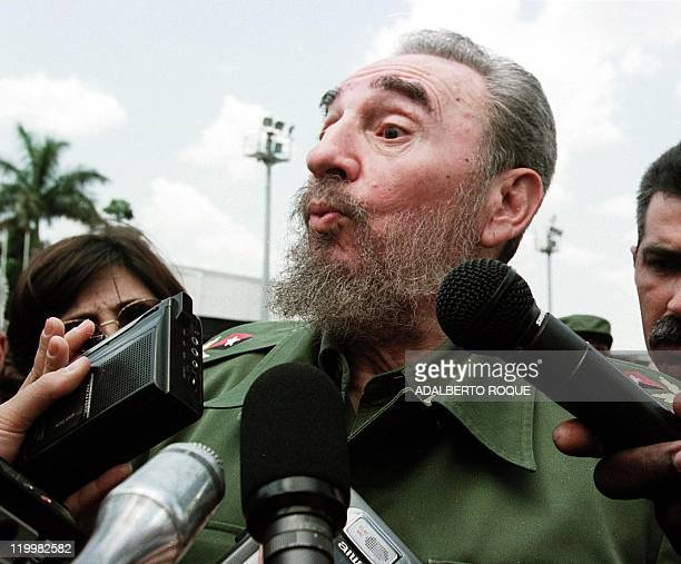 Cuban President Fidel Castro talks to reporters 28 April at the Jose Marti Airport in Havana after he bid farewell to Canadian Prime Minister Jean...