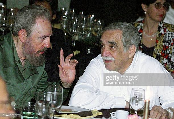 Cuban President Fidel Castro talks with the Colombian Nobel Laureate of Literature Gabriel Garcia Marquez during a dinner at the closing of the Cuban...