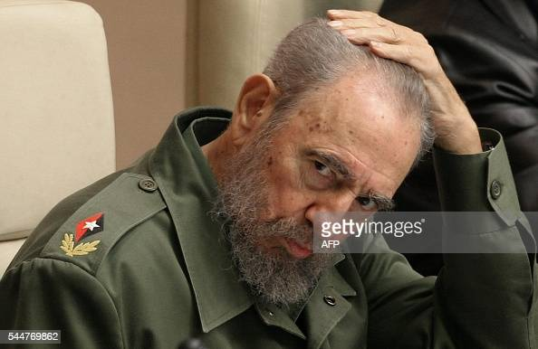 Cuban President Fidel Castro touches his head while attending the VII International Meeting about Globalization in Havana 12 February 2005 where he...