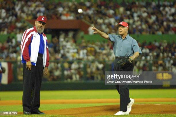 Cuban President Fidel Castro watches former US President Jimmy Carter throw a baseball prior to the start of a a friendly baseball match between two...