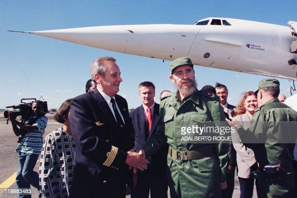Cuban President Fidel Castro welcomes Hetru Claude Air France captain of the Concorde on the first landing of the supersonic commercial airplane at...