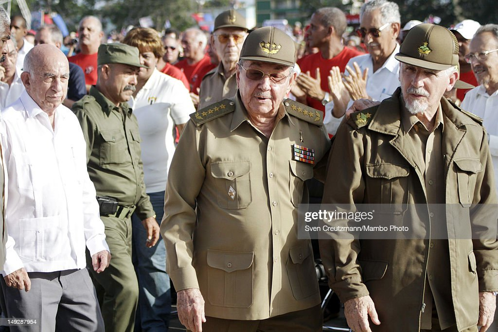 Cuban President Raul Castro (2nd R), accompanied by Commander Ramiro Valdez (R) and Cuban Vice President, Jose Ramon Machado Ventura (L), leaves after an event to commemorate the 59th anniversary of the attack of the Moncada barracks that was led by Fidel Castro in 1953, on July 12, 2012, in Guantanamo, Cuba. Castro, who was not expected to speak, again offered talks with the U.S. but under the condition they speak as of equals.