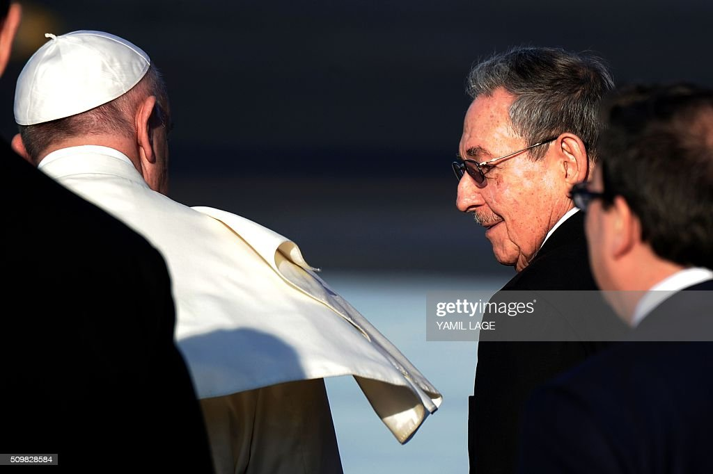 Cuban President Raul Castro accompanies Pope Francis (L) at Jose Marti International Airport in Havana, as he prepares to leave for Mexico on February 12, 2016. Pope Francis and Russian Orthodox Patriarch Kirill kissed each other and sat down together Friday at Havana airport for the first meeting between their two branches of the church in nearly a thousand years. AFP PHOTO/YAMIL LAGE / AFP / YAMIL LAGE
