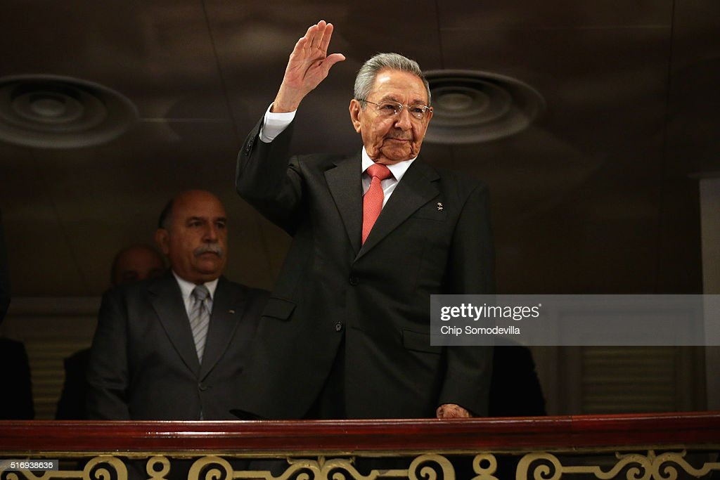 Cuban President <a gi-track='captionPersonalityLinkClicked' href=/galleries/search?phrase=Raul+Castro&family=editorial&specificpeople=239452 ng-click='$event.stopPropagation()'>Raul Castro</a> (C) acknowledges applause as he arrives at the Gran Teatro de la Habana Alicia Alonso to hear a speech by U.S. President Barack Obama in the hisoric Habana Vieja, or Old Havana, neighborhood March 22, 2016 in Havana, Cuba. Described as a message to the Cuban people about his vision for the future of Cuba, Obama's speech will be nationally televised to the 11 million people on the communist-controlled island.