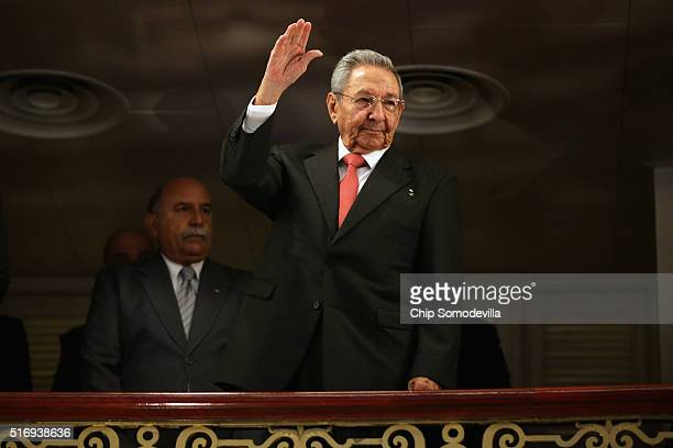 Cuban President Raul Castro acknowledges applause as he arrives at the Gran Teatro de la Habana Alicia Alonso to hear a speech by US President Barack...