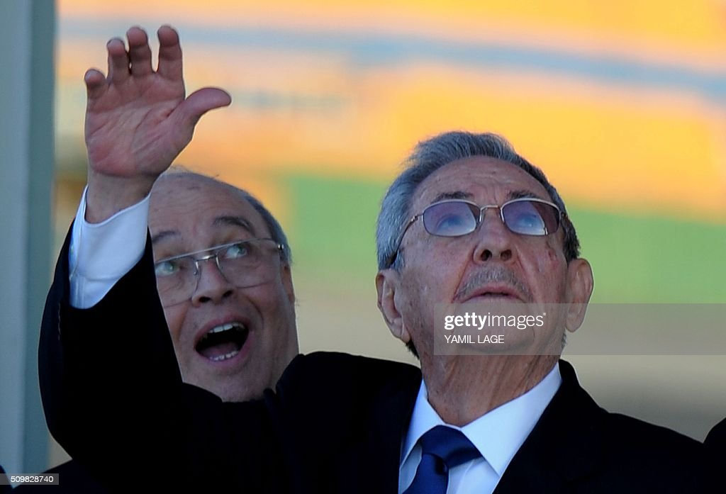 Cuban President Raul Castro (R) and Cuban Cardinal Jaime Ortega wave to Pope Francis at Jose Marti International Airport in Havana as his plane takes off for Mexico on February 12, 2016. Pope Francis and Russian Orthodox Patriarch Kirill kissed each other and sat down together Friday at Havana airport for the first meeting between their two branches of the church in nearly a thousand years. AFP PHOTO/YAMIL LAGE / AFP / YAMIL LAGE
