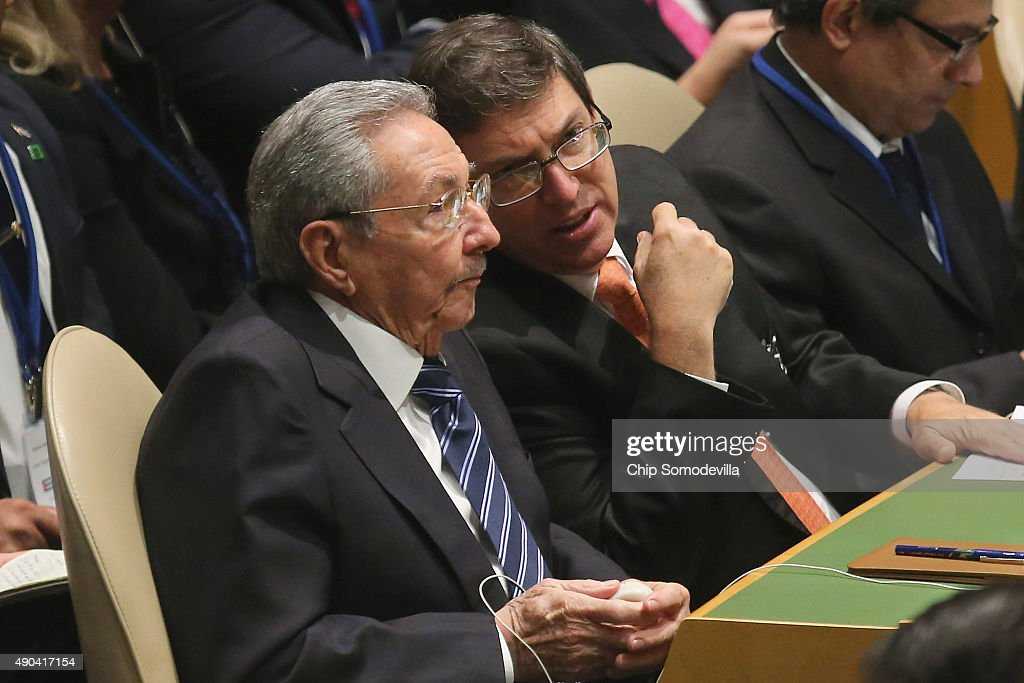 Cuban President Raul Castro (L) and Cuban Foreign Minister Bruno Rodriguez Parrilla listen to U.S. President Barack Obama addresses the 70th annual United Nations General Assembly at the UN headquarters September 28, 2015 in New York City. Obama will hold bilateral meetings with Indian Prime Minister Narendra Modi and Russian President Vladimir Putin later in the day.