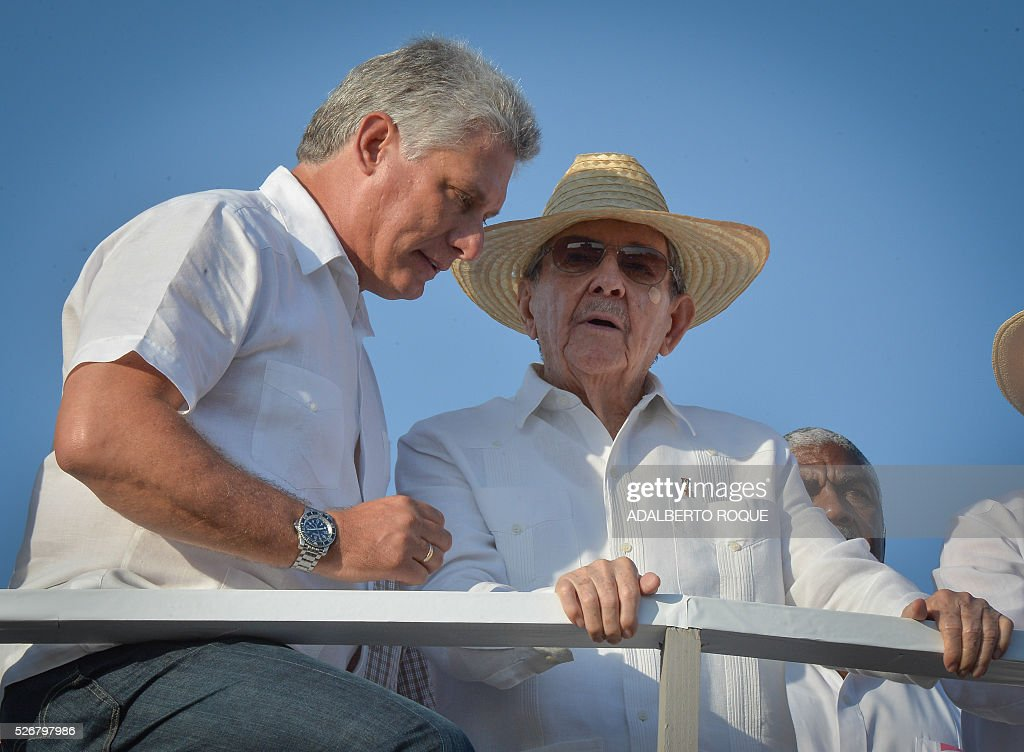 Cuban President Raul Castro (R) and First Vice-President Miguel Diaz Canel attend the May Day parade at Revolution Square in Havana, on May 1, 2016. At right vice president Jose Ramin Machado Ventura. / AFP / ADALBERTO