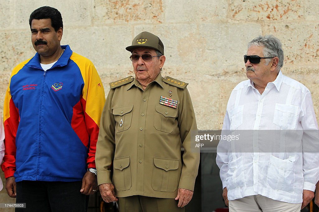 Cuban President Raul Castro (C), and his counterparts from Venezuela Nicolas Maduro (L) and Uruguay Jose Mujica, attend a ceremony at Jose Marti grave in Santa Efigenia cemetery in Santiago de Cuba, on July 26, 2013, as part of celebrations of the 60th Anniversary of Moncada barrack attack in Santiago de Cuba. Cuba on Friday launched 60th anniversary celebrations of ex-leader Fidel Castro's Moncada Barracks assault -- widely seen as the start to the country's communist revolution. The events, led by current President Raul Castro, kicked off in the courtyard of the former Moncada Garrison, where in 1953, a young Fidel Castro and more than 100 rebels attempted to overthrow the dictator Fulgencio Batista. The bid was unsuccessful, but Castro eventually toppled Batista in 1959, launching the Americas' only communist regime, which he ruled for five decades before stepping aside for health reasons in favour of his brother.