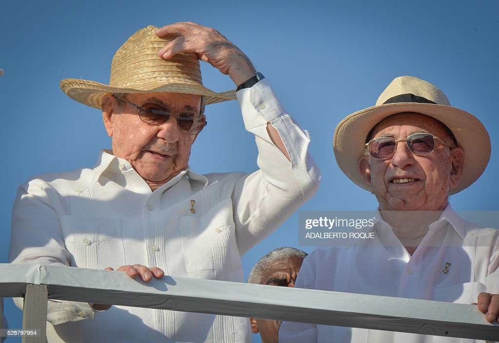 Cuban President Raul Castro (L) and Vice-President Jose Ramon Machado Ventura attend the May Day parade at Revolution Square in Havana, on May 1, 2016. At right vice president Jose Ramin Machado Ventura. / AFP / ADALBERTO