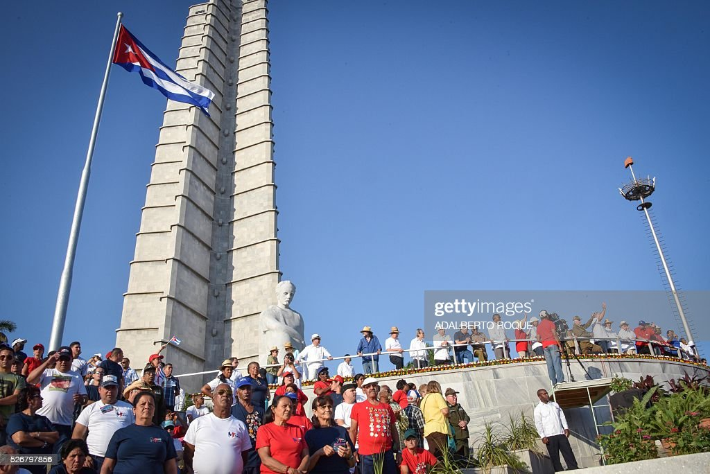 Cuban President Raul Castro (at right with other government authorities) attends the May Day parade at Revolution Square in Havana, on May 1, 2016. / AFP / ADALBERTO
