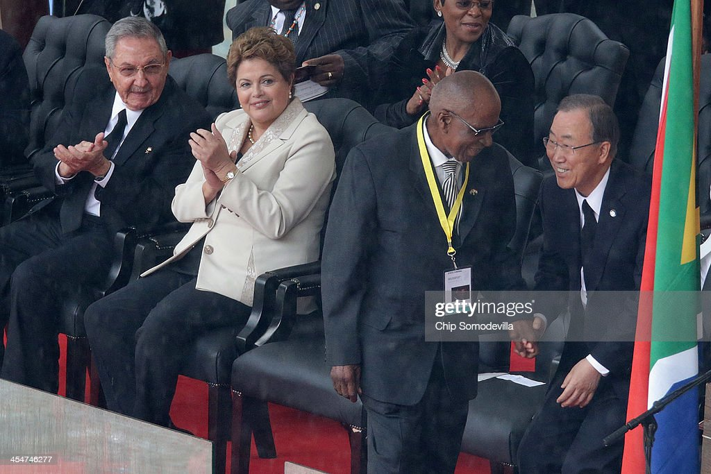 Cuban President <a gi-track='captionPersonalityLinkClicked' href=/galleries/search?phrase=Raul+Castro&family=editorial&specificpeople=239452 ng-click='$event.stopPropagation()'>Raul Castro</a>, Brazilian President <a gi-track='captionPersonalityLinkClicked' href=/galleries/search?phrase=Dilma+Rousseff&family=editorial&specificpeople=1955968 ng-click='$event.stopPropagation()'>Dilma Rousseff</a>, Andrew Mlangeni and UN Secretary General <a gi-track='captionPersonalityLinkClicked' href=/galleries/search?phrase=Ban+Ki-Moon&family=editorial&specificpeople=206144 ng-click='$event.stopPropagation()'>Ban Ki-Moon</a> attend the official memorial service for former South African President Nelson Mandela at FNB Stadium December 10, 2013 in Johannesburg, South Africa. Over 60 heads of state have travelled to South Africa to attend a week of events commemorating the life of former South African President Nelson Mandela. Mr Mandela passed away on the evening of December 5, 2013 at his home in Houghton at the age of 95. Mandela became South Africa's first black president in 1994 after spending 27 years in jail for his activism against apartheid in a racially-divided South Africa.