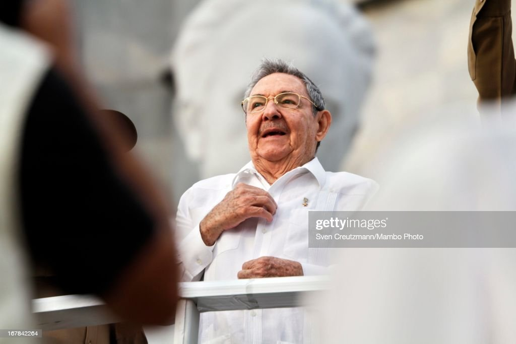 Cuban President <a gi-track='captionPersonalityLinkClicked' href=/galleries/search?phrase=Raul+Castro&family=editorial&specificpeople=239452 ng-click='$event.stopPropagation()'>Raul Castro</a> (C), brother of Revolution leader Fidel Castro, watches the annual May Day parade of hundreds of Cubans at the Revolution Square on May 1, 2013 in Havana, Cuba. Former president Fidel Castro last attended a May Day parade in 2006, before he fell ill, just two months later.