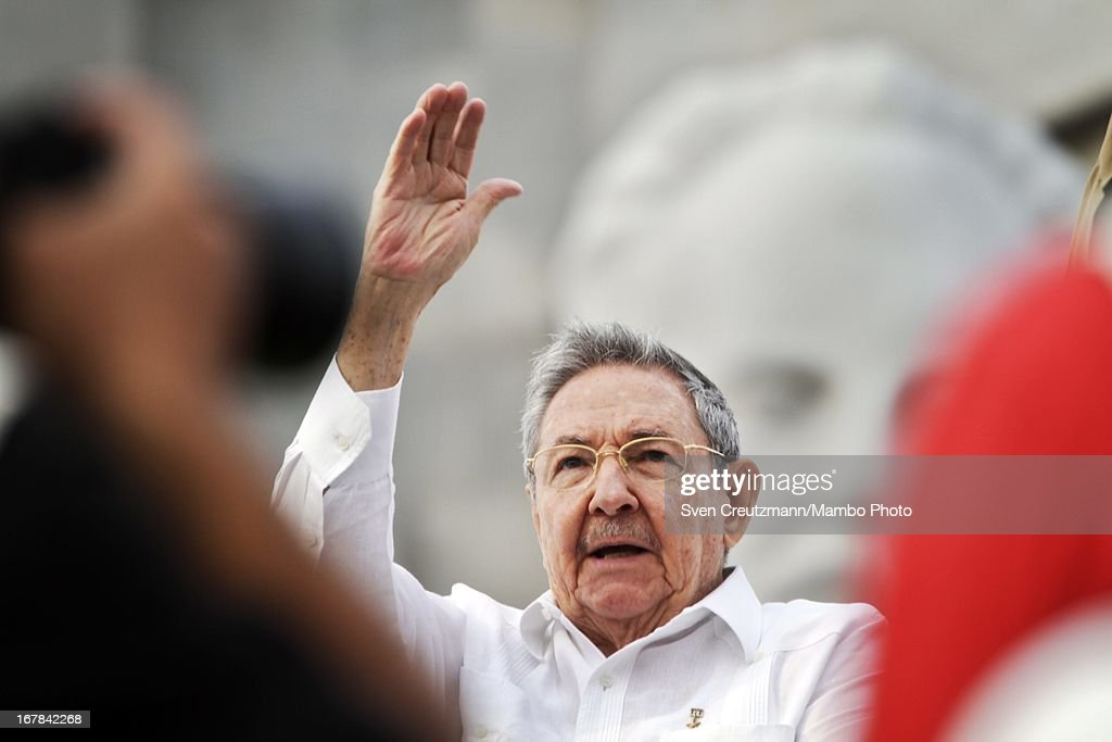 Cuban President <a gi-track='captionPersonalityLinkClicked' href=/galleries/search?phrase=Raul+Castro&family=editorial&specificpeople=239452 ng-click='$event.stopPropagation()'>Raul Castro</a> (C), brother of Revolution leader Fidel Castro, waves to the crowd as observing the annual May Day parade of hundreds of Cubans at the Revolution Square on May 1, 2013 in Havana, Cuba. Former president Fidel Castro last attended a May Day parade in 2006, before he fell ill, just two months later.