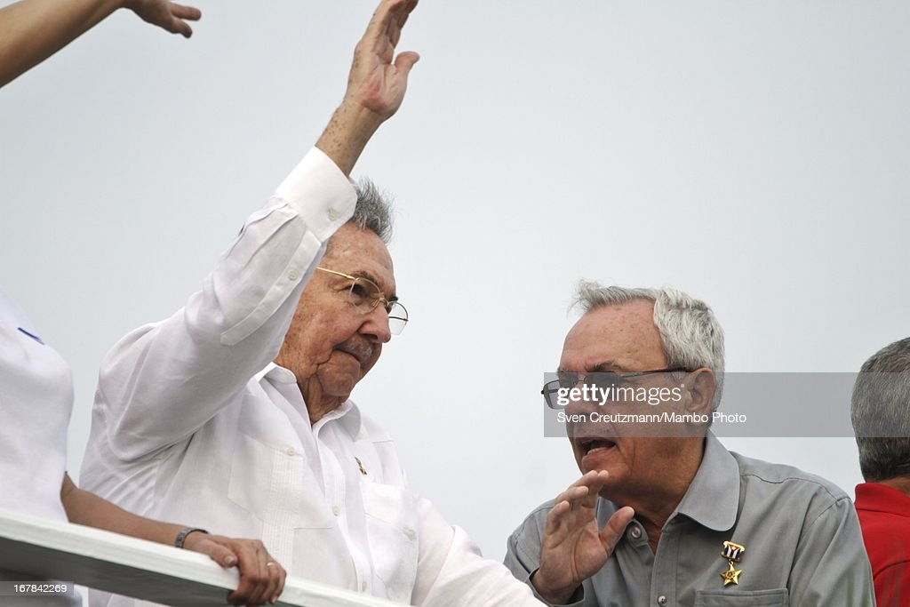 Cuban President <a gi-track='captionPersonalityLinkClicked' href=/galleries/search?phrase=Raul+Castro&family=editorial&specificpeople=239452 ng-click='$event.stopPropagation()'>Raul Castro</a> (L), brother of Revolution leader Fidel Castro, talks to Eusebio Leal (R), Havana's historian and head restorator as observing the annual May Day parade of hundreds of Cubans at the Revolution Square on May 1, 2013 in Havana, Cuba. Former president Fidel Castro last attended a May Day parade in 2006, before he fell ill, just two months later.