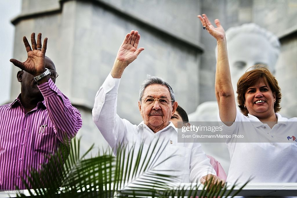 Cuban President Raul Castro (C), brother of Revolution leader Fidel Castro, waves to the crowd as observing the annual May Day parade of hundreds of Cubans at the Revolution Square on May 1, 2013 in Havana, Cuba. Former president Fidel Castro last attended a May Day parade in 2006, before he fell ill, just two months later.