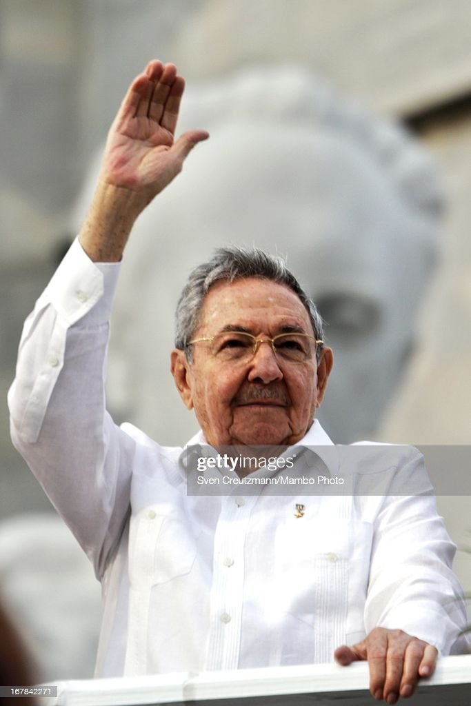 Cuban President <a gi-track='captionPersonalityLinkClicked' href=/galleries/search?phrase=Raul+Castro&family=editorial&specificpeople=239452 ng-click='$event.stopPropagation()'>Raul Castro</a> brother of Revolution leader Fidel Castro, waves to the crowd as observing the annual May Day parade of hundreds of Cubans at the Revolution Square on May 1, 2013 in Havana, Cuba. Former president Fidel Castro last attended a May Day parade in 2006, before he fell ill, just two months later.