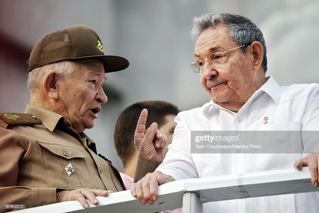 Cuban President <a gi-track='captionPersonalityLinkClicked' href=/galleries/search?phrase=Raul+Castro&family=editorial&specificpeople=239452 ng-click='$event.stopPropagation()'>Raul Castro</a> (R), brother of Revolution leader Fidel Castro, listens to Guillermo Garcia Frias (L) as observing the annual May Day parade of hundreds of Cubans at the Revolution Square on May 1, 2013 in Havana, Cuba. Former president Fidel Castro last attended a May Day parade in 2006, before he fell ill, just two months later.