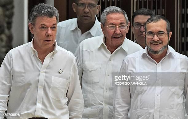 Cuban President Raul Castro Colombian President Juan Manuel Santos and the head of the FARC guerrilla Timoleon Jimenez aka Timochenko arrive for a...