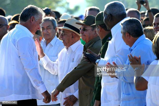 Cuban President Raul Castro greets First Vice President Miguel Diaz Canel during the homage for the 50th anniversary of Ernesto 'Che' Guevara's death...