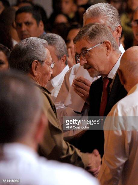 Cuban President Raul Castro greets Russian Ambassador to Cuba Mikhail L Kamynin during celebations marking the 100th anniversary of the 1917...