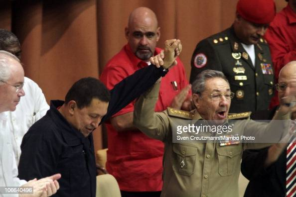 Cuban President Raul Castro raises the arm of Venezuela President Hugo Chavez at the end of a meeting to celebrate the 10th anniversary of the...