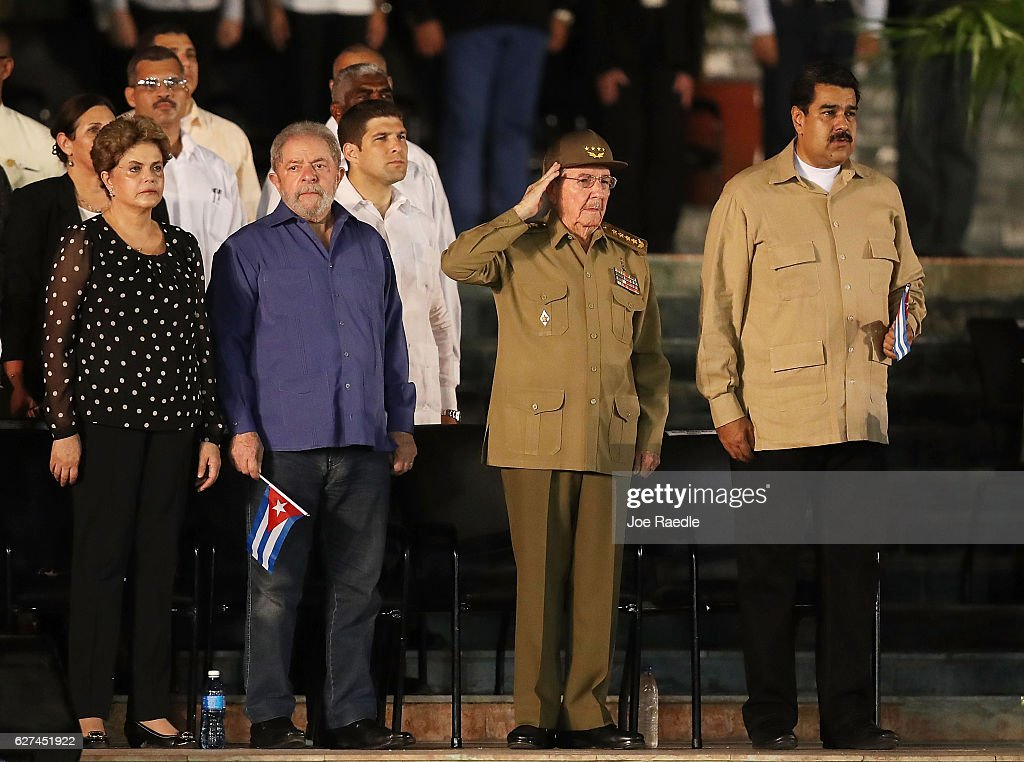 Cuban President Raul Castro (2nd R) salutes during the Cuban National Anthem as he stands with Brazilian impeached former president Dilma Rousseff (L), former Brazilian President Luiz Inacio Lula da Silva (2nd L) and Venezuela President Nicolas Maduro (R) during a memorial tribute for former President of Cuba Fidel Castro at the Antonio Maceo Revoloution Square before his burial tomorow on December 3, 2016 in Santiago de Cuba, Cuba. Mr. Castro died on November 25th at the age of 90 and the country is in the midst of a 9 day mourning period that lasts until his funeral on Sunday in Santiago de Cuba at the CementerioÊSanta Ifigenia.