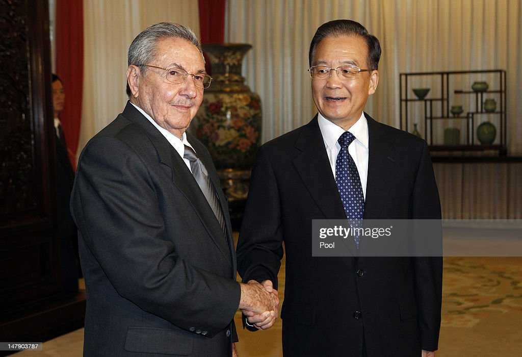 Cuban President <a gi-track='captionPersonalityLinkClicked' href=/galleries/search?phrase=Raul+Castro&family=editorial&specificpeople=239452 ng-click='$event.stopPropagation()'>Raul Castro</a> (L) shakes hand with Chinese Premier <a gi-track='captionPersonalityLinkClicked' href=/galleries/search?phrase=Wen+Jiabao&family=editorial&specificpeople=204598 ng-click='$event.stopPropagation()'>Wen Jiabao</a> during a meeting held at the Zhongnanhai diplomatic compound on July 6, 2012 in Beijing, China. Eight agreements have been signed, including two for donations and interest-free Beijing loans to Havana. Castro is making his first visit to China since taking office as president