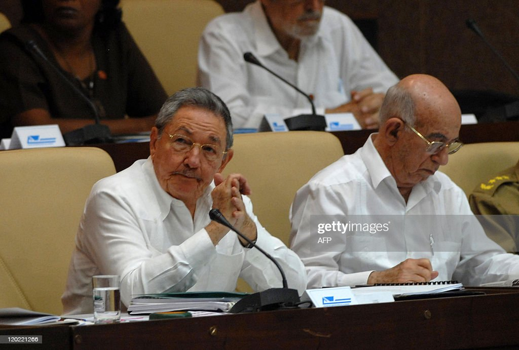 Cuban President Raul Castro (L) speaks beside First Vice-President Jose Ramon Machado Ventura before the National Assembly at the Parliament in Havana on August 1, 2011.