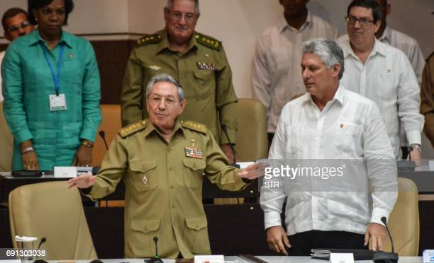 Cuban President Raul Castro speaks next to first vice president Miguel DiazCanel during a special session of the Cuban Parliament on June 1 to...