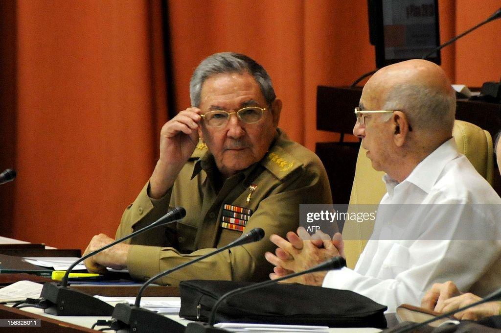 Cuban President Raul Castro (L) takes part in the annual Parliament meeting on December 13, 2012 in Havana, next to First Vice-president of Cuba Jose Ramon Machado Ventura. AFP PHOTO/Omara GARCIA