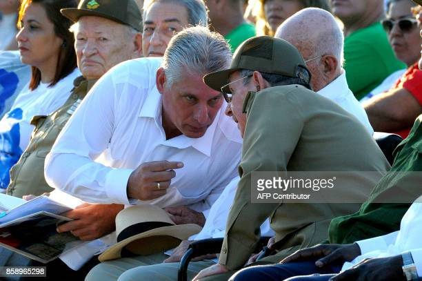 Cuban President Raul Castro talks with First Vice President Miguel Diaz Canel during the homage for the 50th anniversary of Ernesto 'Che' Guevara's...