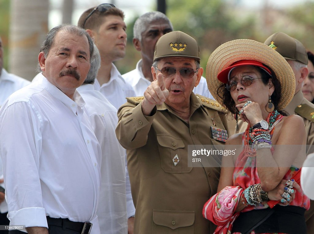 Cuban President Raul Castro (C) talks with Nicaraguan President Daniel Ortega (L) and Ortega's wife Rosario Murillo (R), on July 26, 2013, during celebrations of the 60th Anniversary of Moncada barrack attack in Santiago de Cuba. Cuba on Friday launched 60th anniversary celebrations of ex-leader Fidel Castro's Moncada Barracks assault -- widely seen as the start to the country's communist revolution. The events, led by current President Raul Castro, kicked off in the courtyard of the former Moncada Garrison, where in 1953, a young Fidel Castro and more than 100 rebels attempted to overthrow the dictator Fulgencio Batista. The bid was unsuccessful, but Castro eventually toppled Batista in 1959, launching the Americas' only communist regime, which he ruled for five decades before stepping aside for health reasons in favour of his brother. At left, Nicaraguan President Daniel Ortega. AFP PHOTO/STR