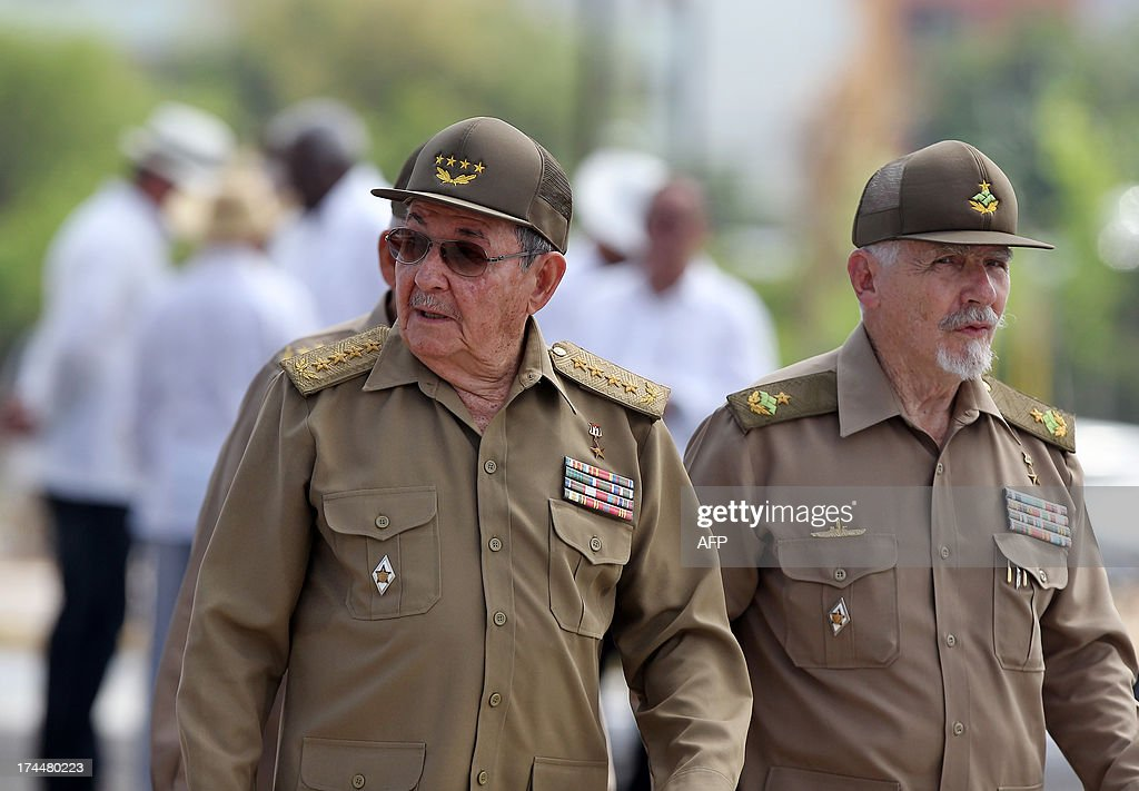Cuban President Raul Castro (L) walks with Vice-President of the Council of State Ramiro Valdez on July 26, 2013 during celebrations of the 60th Anniversary of Moncada barrack attack in Santiago de Cuba. Cuba on Friday launched 60th anniversary celebrations of ex-leader Fidel Castro's Moncada Barracks assault -- widely seen as the start to the country's communist revolution. The events, led by current President Raul Castro, kicked off in the courtyard of the former Moncada Garrison, where in 1953, a young Fidel Castro and more than 100 rebels attempted to overthrow the dictator Fulgencio Batista. The bid was unsuccessful, but Castro eventually toppled Batista in 1959, launching the Americas' only communist regime, which he ruled for five decades before stepping aside for health reasons in favour of his brother.